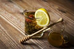 Teapot with tea and lemon slice Stock Photos