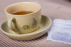 Teapot and tea in paper Stock Photos