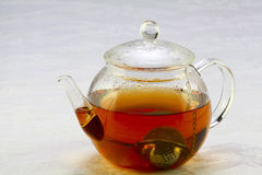 Teapot with tea strainer Royalty Free Stock Photography