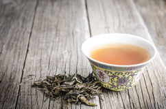 Teapot with tea on a wooden background Stock Image