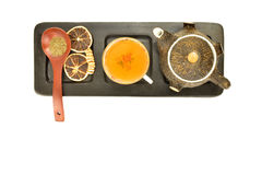 Teapot tea wooden spoon and dried orange isolated Stock Images