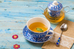 Teapot and teacup Stock Image