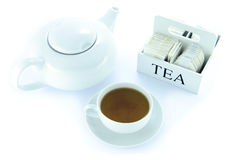 Teapot and teacup with a set of tea bags Stock Photo