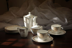 Teapot And Teacup Sitting Stock Photography