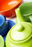 Teapot and teacups Stock Images