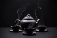 Teapot and teacups Stock Photography