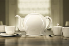 Teapot and teacups Stock Photo