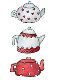 Teapot. Three cute teapot on white background with red ornament Stock Photo