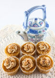 Teapot and toffee cream cakes Stock Photo