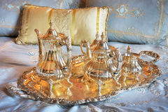 Teapot a tray and bed Stock Image