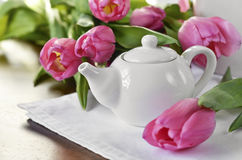 Teapot and tulips on a  napkin Royalty Free Stock Photos