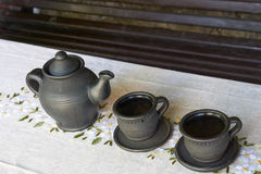 Teapot with two cups on a table Royalty Free Stock Images