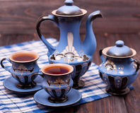 Teapot and two cups of tea on a wooden background Stock Photo