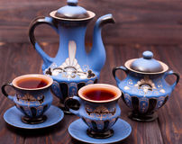 Teapot and two cups of tea on a wooden background Royalty Free Stock Photography