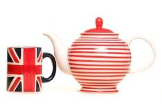 Teapot and union jack mug. Studio cutout Royalty Free Stock Photo