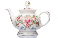 Teapot white porcelain with patterns for drinks. On a white background Royalty Free Stock Photography