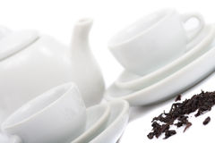 Teapot and white teacup Stock Photo