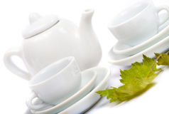 Teapot and white teacup Stock Images