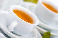 Teapot and white teacup Stock Photo