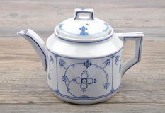 Teapot on wood Royalty Free Stock Images