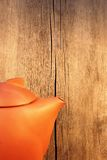 Teapot on a Wooden Table and wood background Stock Photos