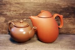 Teapot on a Wooden Table and wood background Royalty Free Stock Photography
