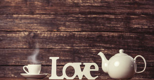 Teapot and word Love stock images