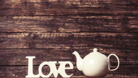 Teapot and word Love stock photography