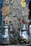 Teapots and the background metal hands. In Chefchaouen, Morocco, north Africa Stock Photo
