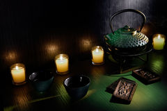 Teapots and candles Royalty Free Stock Images