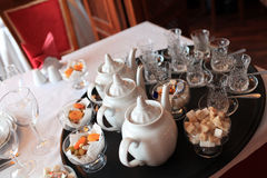 Teapots and cups Stock Photos