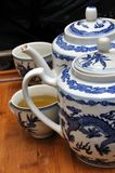 Teapots, cups and tea Stock Photography
