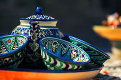 Teapots with cups. Traditional asian teapot with cups on the plate Stock Photo