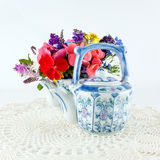 Teapots with flowers Stock Photos