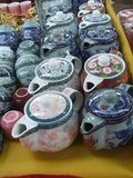 Teapots at a market for sale Stock Image