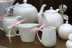 Teapots and milk jugs Stock Image