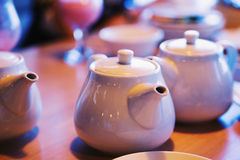Teapots with patches of light. Teapots on a table covered with patches of light Stock Photos