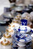 Teapots and plates Royalty Free Stock Photos