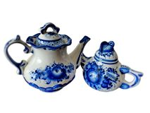 Teapots in Russian traditional Gzhel style on a white background. Gzhel - Russian folk craft of ceramics Royalty Free Stock Photo