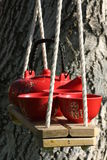 Teapots on swing Royalty Free Stock Photos