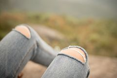 Tear blue jeans. Close up tear blue jeans Royalty Free Stock Photography