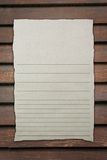 Tear brown paper with line on wood background royalty free stock photos