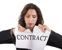 Tear the contract. Annoyed businesswoman tears the document work contract Royalty Free Stock Photo