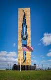 Tear Drop Memorial in Bayonne, New Jersey. American Flag in front of the Tear Drop Memorial in Bayonne, New Jersey, USA. Zurab Tsereteli's  memorial symbolizes Stock Photo