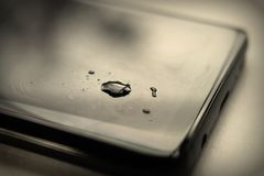 Tear Drop on Phone stock photos