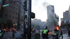 Tear gas exploding at chaotic downtown riot
