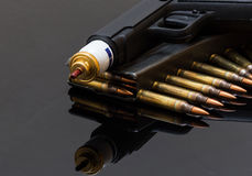 Tear gas pistol and rifle bullets Royalty Free Stock Photography