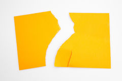 Tear half orange paper isolated. White background Stock Photography