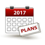 Tear-off calendar with a note with a title plans. On a white Royalty Free Stock Photo