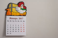 Tear-off calendar, a symbol of the new year rooster,. White background Royalty Free Stock Image